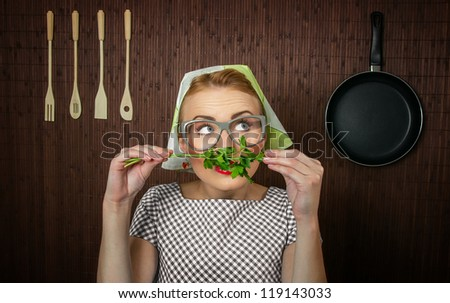 Funny woman cook with parsley - close up