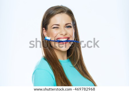 Funny woman face holding toothbrush in mouth. White background.