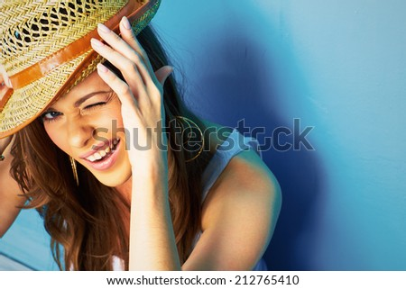 funny woman portrait on blue background - stock photo