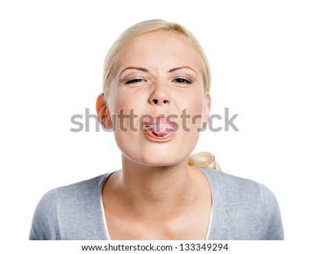 Funny woman showing her tongue, isolated on white - stock photo