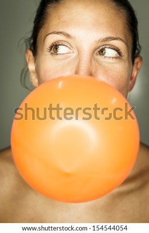 funny woman with balloon - stock photo