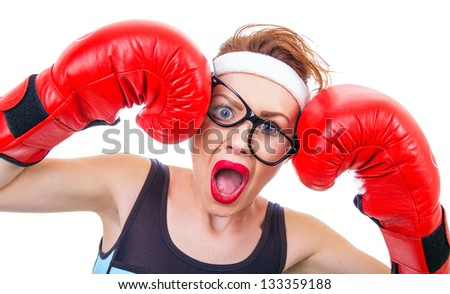 Funny woman with boxing gloves screaming, isolated on white - stock photo