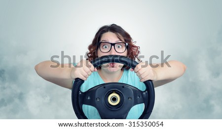 Funny woman with car wheel and smoke - stock photo