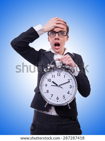 Funny woman with clock against the gradient - stock photo