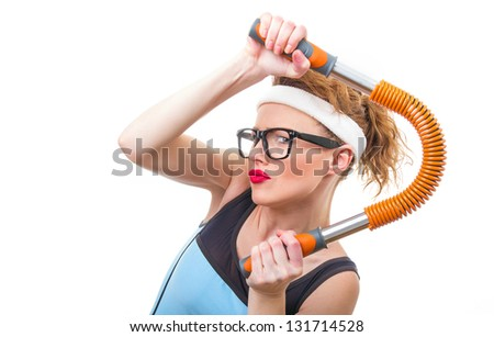 Funny woman with expander, fitness girl over white background - stock photo