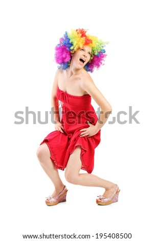 Funny woman with wig on her head isolated on white background - stock photo