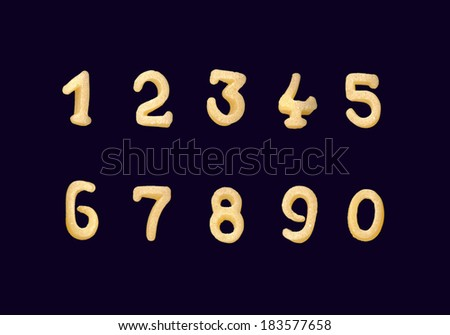 Funny yellow numerals from cereals products isolated on a black background - stock photo