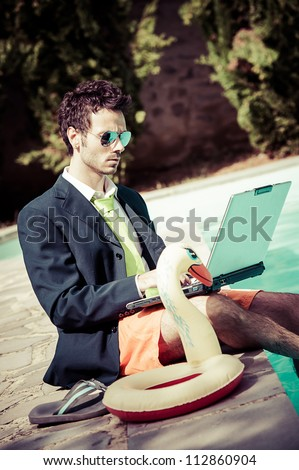 Funny Young Businessman with SwimmingTrunks next to the Pool,Italy - stock photo