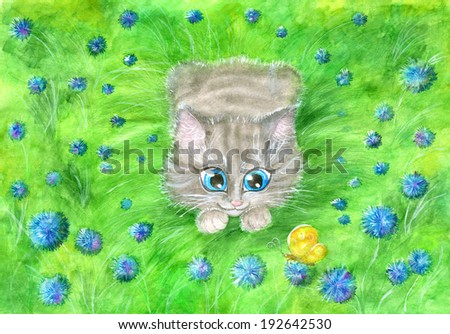 Funny young cat playing in the field with butterfly among the blue flowers - stock photo