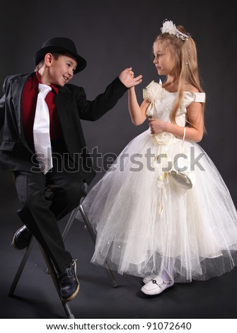 funny young couple on dark background
