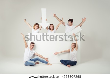 Funny Young Friends with White Blank Board and Arrows for Advertisement, Captured in Studio on Off-White Background. - stock photo