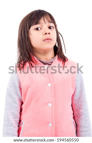 Funny young girl making faces isolated in white