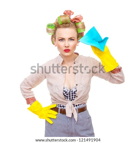 Funny young housewife with gloves holding rag / wipe, isolated on white. Pin-up girl