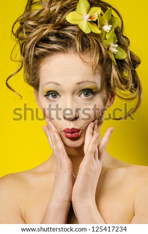 Funny young lady portrait over yellow background