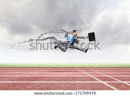 Funny young office worker running in a hurry