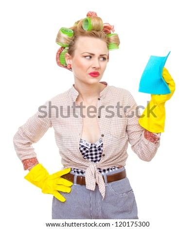 Funny young unhappy housewife with gloves holding rag / wipe, isolated on white. Pin-up girl - stock photo