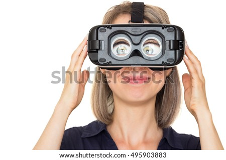funny young woman using vr glasses. Virtual reality headset. Isolated