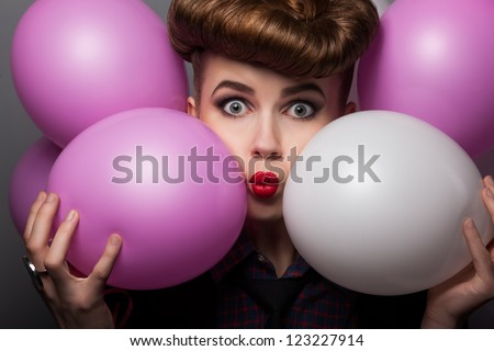 Funny Young Woman with Colorful Air Balloons Enjoying - Grimace - stock photo