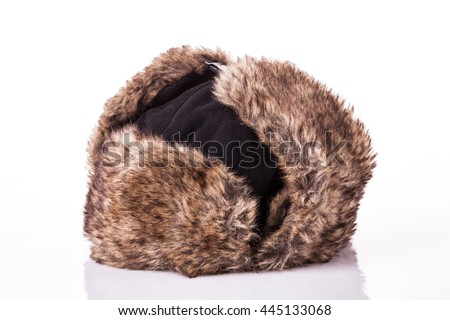 Fur cap for winter weather. Fur cap for winter isolated on white background