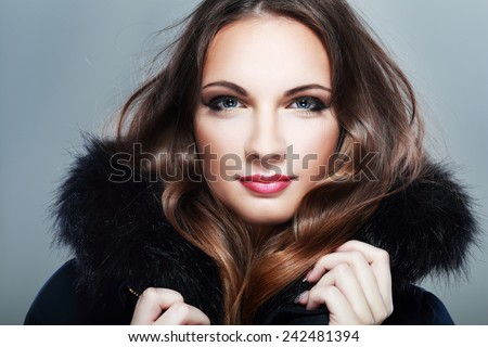 Fur Fashion. Beautiful Girl in Fur Hood. Winter Woman Portrait - stock photo
