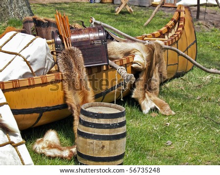 fur pelts and trunk in Indian canoe