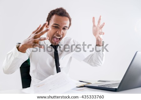 Furious african american businessperson in office sick and tired of endless paperwork - stock photo