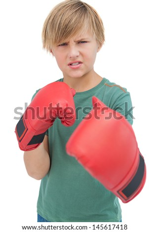 Furious blonde boy with boxing gloves on white background  - stock photo