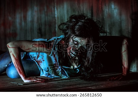 Furious bloody zombie girl. Horror. Halloween.  - stock photo