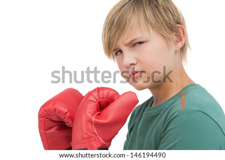 Furious boy with boxing gloves on white background  - stock photo