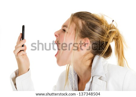 Furious business woman yelling on telephone - stock photo