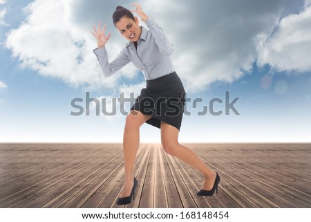 Furious businesswoman gesturing against cloudy sky background