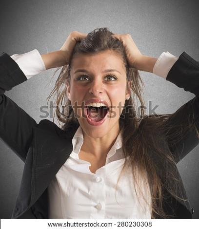Furious businesswoman stressed out from work screams - stock photo