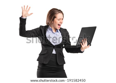 Furious businesswoman yelling at a laptop isolated on white background - stock photo