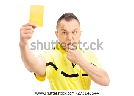 Furious football referee showing a yellow card and blowing a whistle isolated on white background - stock photo