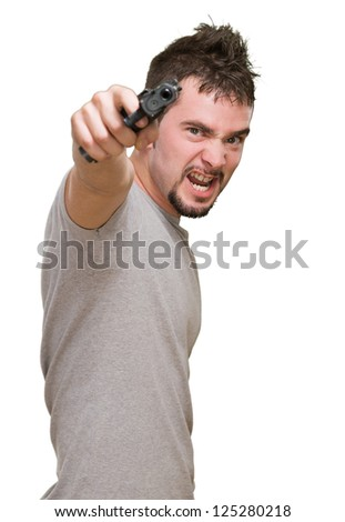 furious man pointing with gun against a white background - stock photo