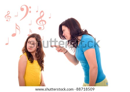 furious mother yelling at her daughter that pretends listening music - stock photo