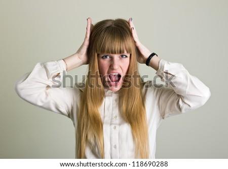 Furious woman shouting - stock photo