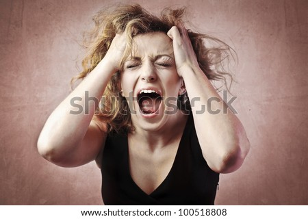 Furious young woman screaming - stock photo