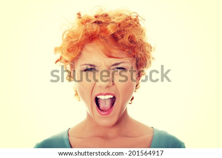 Furiouse young redhead woman screaming