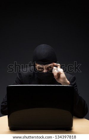 Furitive computer hacker - stock photo