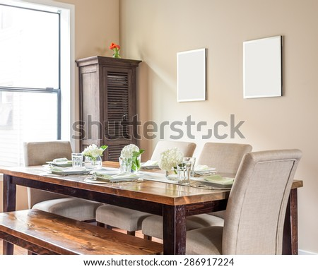 Furnished Dining Room Detail in New Home with Place Settings - stock photo