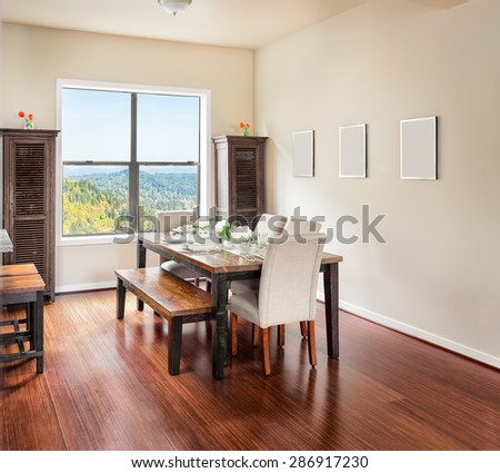 Furnished Dining Room with Place Settings - stock photo