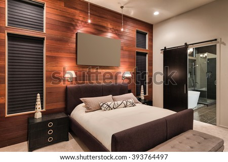 Furnished master bedroom interior in new home with view of bathroom including shower and bathtub