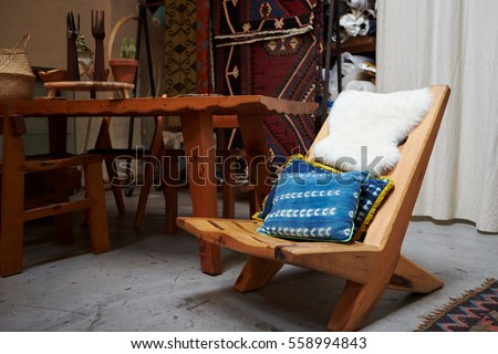 Furniture displayed in a clothes shop, close up, low angle