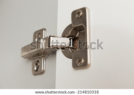 furniture hinge close up view of kitchen cabinet - stock photo