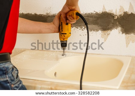 Furniture manufacturing inside working with the drill - stock photo