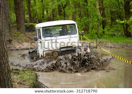 FURSTENAU, GERMANY - MAY 09, 2015: A jeep is driving through a pond of water on a special off the road terrain for land cruisers and vehicles in Germany - stock photo