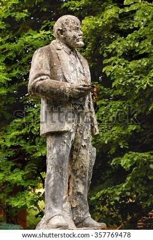 FURSTENBERG, GERMANY  JULY 21, 2008: Shabby and flaky Lenin statue in front of the former Soviet army headquarters after withdrawal of the Soviet troops. - stock photo