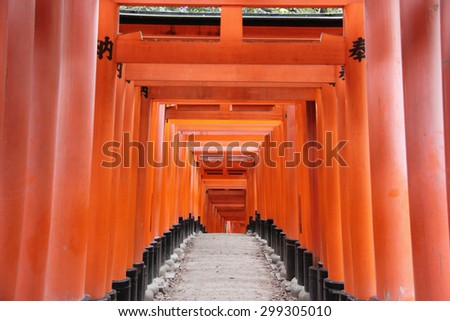 Fushimi Inari Taisha Shrine is the head shrine of Inari including trails up the mountain to many smaller shrines which span 4 kilometers in Kyoto, Japan. - stock photo