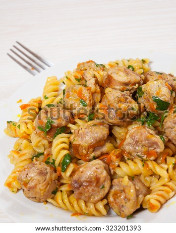Fusilli pasta with sausage and vegetables